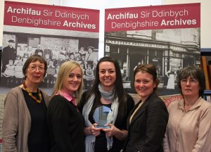 Staff at Denbighshire Archives based in the Old Gaol, Ruthin. From left to right: Jane Brunning (Senior Archivist), Rhian Evans (Archives Assistant), Sarah Winning (Archivist), Lowri Williams (Archives Assistant) and Ellie Williams (Archives Assistant)