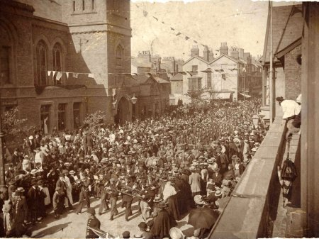 Soldiers of the Old Rhyl Volunteers, 1st RWF, returning from the Boer War, marching to Rhyl Town Hall, 11 May 1901